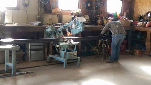 Using hand saw in Fusion Fabrications shop, 6545 E. County Rd. #14, Loveland Colorado